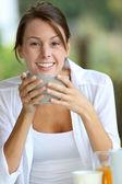 Portrait of beautiful woman having breakfast outside — Stock Photo