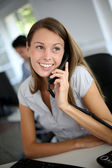 Beautiful office worker talking on the phone — Stock Photo