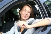 Cheerful girl holding car keys from window — Stock Photo