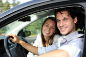 Cheerful couple driving car — Foto Stock