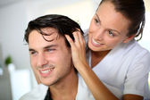 Hairdresser doing head massage to customer — Stock Photo