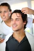 Hairdresser applying hair gel — Stock Photo