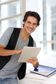 College student using digital tablet at school — Stock Photo