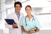 Medical standing in hospital hallway — Stock Photo