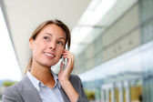 Smiling businesswoman talking on mobile phone — Stock Photo