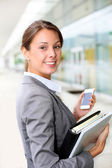 Attractive businesswoman standing outside — Stock Photo