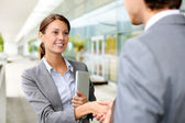Businesswoman shaking hand to partner — Stok fotoğraf