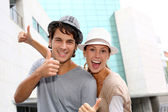 Happy friends showing thumbs up — Stock Photo