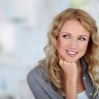 Portrait of beautiful blond woman relaxing at home — Stock Photo #18194923