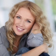 Portrait of beautiful blond woman relaxing at home — Stock Photo