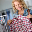 Attractive woman in clothing store — Stock Photo