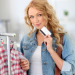 Attractive woman in clothing store — Stock Photo #18196149
