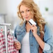 Attractive woman in clothing store - Stock Photo