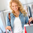 Stock Photo: Smiling woman holding shopping bags