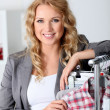 Stock Photo: Beautiful womin garment store
