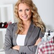Stock Photo: Beautiful woman in garment store
