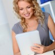 Beautiful woman in office using digital tablet — Stock Photo #18197627