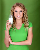 Portrait of woman holding glass of milk — Stock Photo