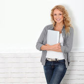 Beautiful modern woman using digital tablet — Stock Photo