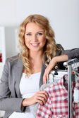 Beautiful woman in garment store — Stock Photo