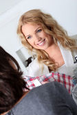 Beautiful woman showing clothes to customer — Foto Stock