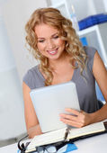 Beautiful woman in office using digital tablet — Stok fotoğraf