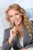 Portrait of beautiful blond businesswoman in office — Stock Photo