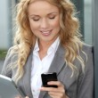 Saleswoman using mobile phone and digital tablet — Stock Photo #18202635