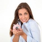 Portrait of beautiful woman holding piggybank — Stock Photo #18208705