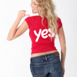Woman wearing red shirt with YES word on it — Stock Photo #18201067