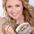 Portrait of beautiful woman eating cereals — Stock Photo #18202073