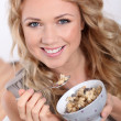 Stock Photo: Portrait of beautiful woman eating cereals
