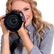 Woman using photo camera in studio - Stock Photo