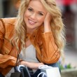 Royalty-Free Stock Photo: Trendy beautiful woman in town with shopping bags