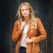 Portrait of beautiful blond woman with leather jacket  — Stock Photo
