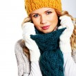 Portrait of woman wearing woolen accessories - Stock Photo