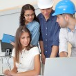 Stock Photo: Group of young architects in business meeting