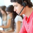 Customer service employee with headphones on — Stock Photo #18206745