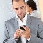 Portrait of businessman using mobile phone — Stock Photo
