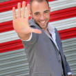 Attractive man showing hand to camera — Stockfoto