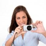 Portrait of beautiful woman using compact digital camera  — Stock Photo #18208663