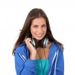 Portrait of teenager listening to music with headphones — Stock Photo