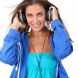 Portrait of teenager listening to music with headphones — Stock Photo #18208797