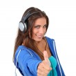 Portrait of teenager listening to music with headphones — Stock Photo #18208803