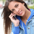 Portrait of young girl using smartphone — Stockfoto