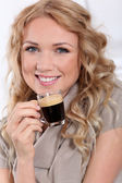 Portrait of blond woman drinking expresso — Stock Photo
