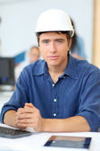 Portrait of student architect with security helmet on — Stock Photo
