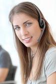 Portrait of customer service woman with headphones — Stock Photo