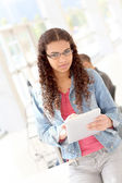 Student using electronic tablet at school — Stock Photo