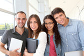 Portrait of cheeful college students — Stock Photo